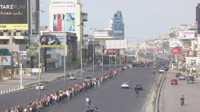 Photo of Lebanese protesters form a 170-KM nationwide human chain