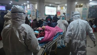 Photo of Chinese premier visits virus epicentre as death toll hits 80