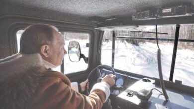 Photo of Putin pilots bumpy all-terrain rig on Siberian holiday