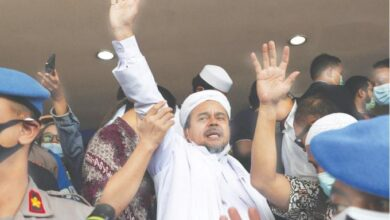 Photo of Indonesia court gives hardline cleric jail term for flouting Covid-19 curbs
