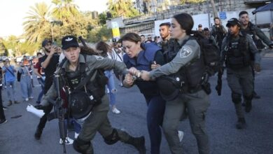 Photo of Al Jazeera reporter forcefully detained by Israel
