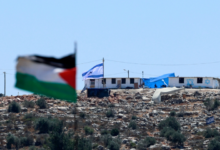 Photo of Israeli settlers leave West Bank outpost after deal with govt